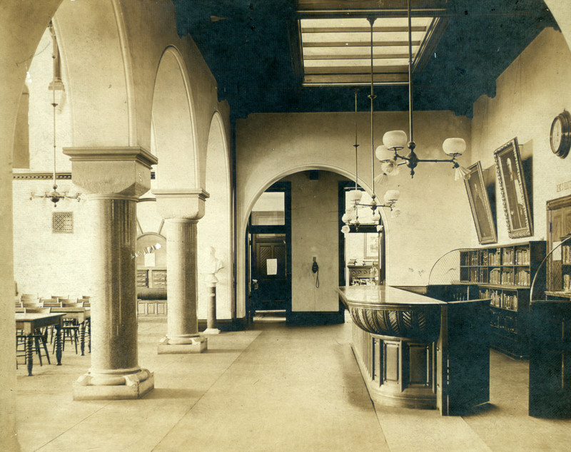 Library circulation desk looking east with reading room door at left, 1910