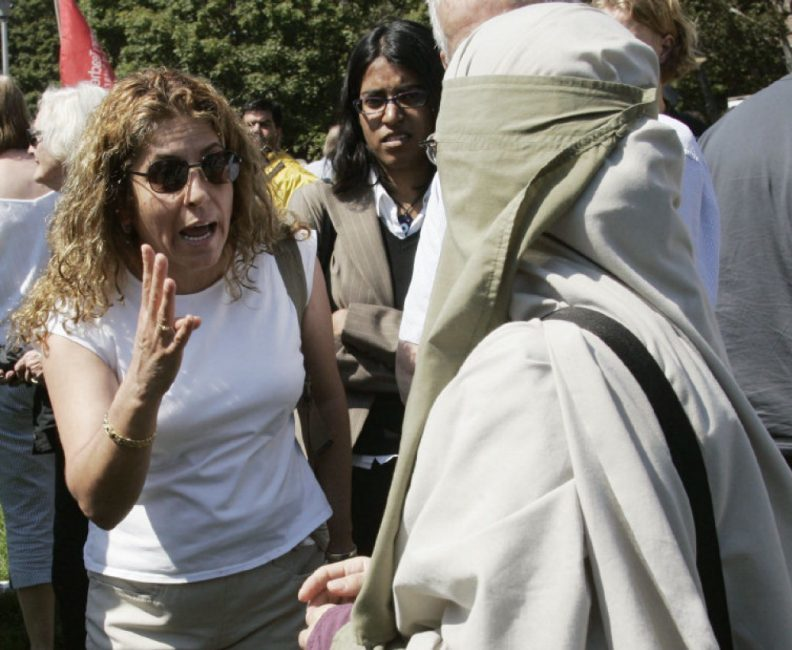 Photograph: A woman argues with Joanne Siska during a protest against Sharia law in Toronto