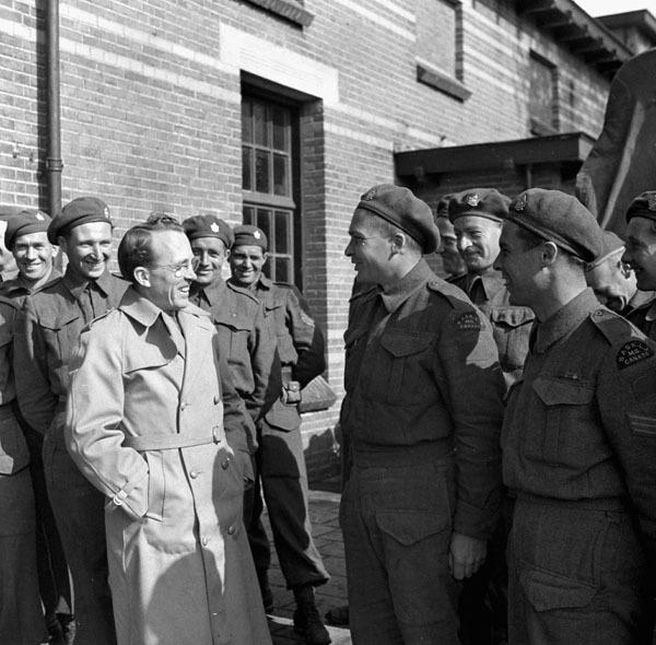 Hon. T.C. Douglas, Premier of Saskatchewan, talking with Private P. Campbell of The Saskatoon Light Infantry (M.G.), Barneveld, Netherlands, 29 April 1945