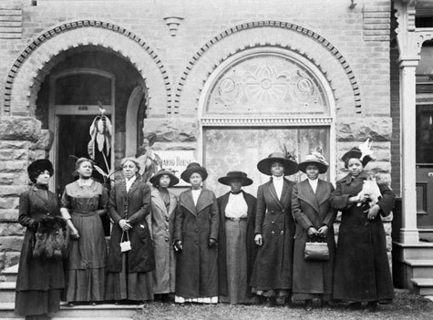 Group of black women in front of the Y.W.C.A. boarding house at 698 Ontario Street, Toronto, Ontario.