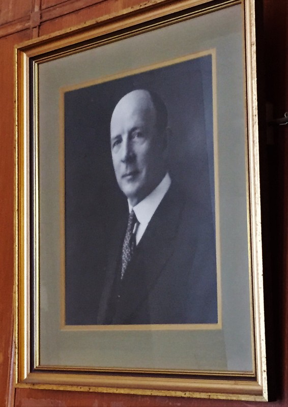 Photograph of an image of Emil Wallberg hanging in the lobby of The Wallberg Building