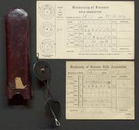 Items from the University of Toronto Rifle Association including score cards and spectacles.