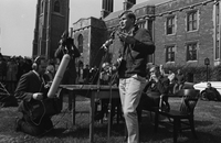 Stephen Langdon, president of the Students' Administrative Council [SAC], debates President Claude Bissell outdoors in front of Hart House
