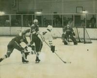 John Wright, of the Varsity Blues Men's Hockey Team, fires a shot at the Cornell goalie, Ken Dryden.Varsity vs. Cornell, 1968